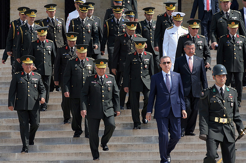 Prime Minister Recep Tayyip Erdogan, center,  Gen. Necdet Ozel, Turkey's new Land Forces Commander and acting Chief of Staff, second left, and top army generals follow a guard of honour at the mausoleum of modern Turkey's founder Kemak Ataturk after the military's annual meeting in Ankara, Turkey, Monday, Aug. 1, 2011. Turkish Chief of Staff Gen. Isik Kosaner and the commanders of the navy, the army and the air force suddenly resigned Friday, July 29, 2011 to protest the arrest of dozens of generals as suspects in an alleged plot to overthrow the country's Islamic-rooted government. Many have questioned whether such a plot ever existed and see the arrests as part of Prime Minister Recep Tayyip Erdogan's long-standing campaign to establish civilian authority over Turkey's once powerful military. Government appointed Gen. Ozel as the new Land force commander and acting Chief of Staff early Saturday, July 30, 2011.(AP Photo)