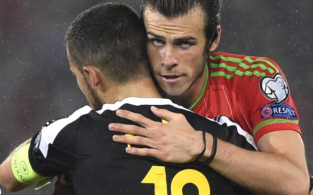 Football - Wales v Belgium - UEFA Euro 2016 Qualifying Group B - Cardiff City Stadium, Cardiff, Wales - 12/6/15  Wales' Gareth Bale and Belgium's Eden Hazard at the end of the match  Reuters / Rebecca Naden  Livepic