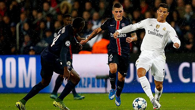 PARIS, FRANCE - OCTOBER 21: Cristiano Ronaldo (R) of Real Madrid competes for the ball with Blaise Matuidi Paris Saint-Germain during the UEFA Champions League Group A match between Paris Saint-Germain and Real Madrid at Parc des Princes stadium on October 21, 2015 in Paris, France. (Photo by Antonio Villalba/Real Madrid via Getty Images)