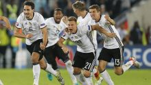 German players celebrate after winning the penalty shootout of the Euro 2016 quarterfinal soccer match between Germany and Italy, at the Nouveau Stade in Bordeaux, France, Saturday, July 2, 2016. (AP Photo/Michael Probst)