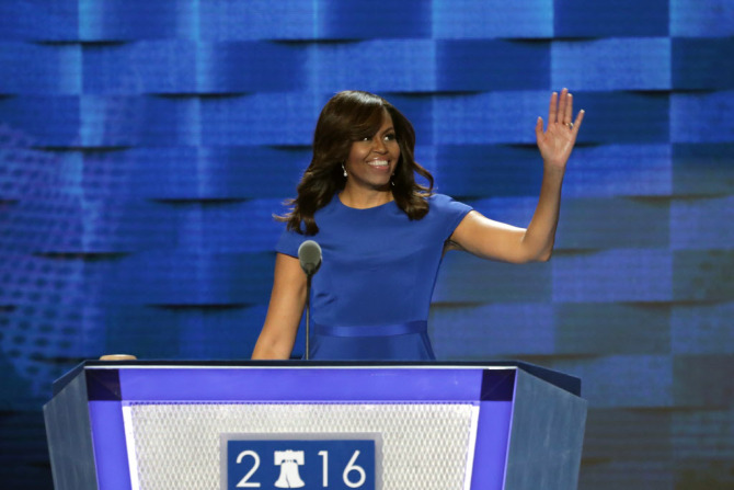 PHILADELPHIA, PA - JULY 25:  First lady Michelle Obama waves to the crowd before delivering remarks on the first day of the Democratic National Convention at the Wells Fargo Center, July 25, 2016 in Philadelphia, Pennsylvania. An estimated 50,000 people are expected in Philadelphia, including hundreds of protesters and members of the media. The four-day Democratic National Convention kicked off July 25.  (Photo by Alex Wong/Getty Images) ORG XMIT: 655802065