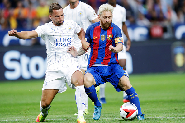 SOLNA, SWEDEN - AUGUST 03: Robert Huth of Leicester City FC and Lionel Messi of FC Barcelona compete for the ball during the Pre-Season Friendly between Leicester City FC and FC Barcelona at Friends arena on August 3, 2016 in Solna, Sweden. (Photo by Nils Petter Nilsson/Ombrello/Getty Images)
