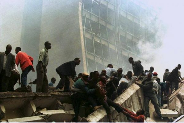 An injured man is removed from the wreckage after a bomb went off in Nairobi, Kenya, in this file photo from August 7, 1998.  REUTERS/Files