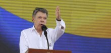 "Colombia's President Juan Manuel Santos speaks during an event to promote the ""yes"" vote in the upcoming referendum on the peace deal he signed with rebels of the Revolutionary Armed Forces of Colombia, FARC, in Soacha, on the outskirts of Bogota, Colombia, Friday, Sept. 30, 2016.  Colombians go to the polls on Oct. 2 in a referendum where they will be asked to ratify or reject the deal. (AP Photo/Fernando Vergara)/XRM101/16274649145669/1609302026"