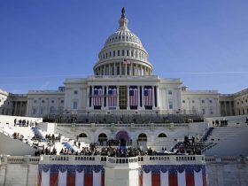 The U.S. Capitol looms over a stage during a rehearsal of President-elect Donald Trump's swearing-in ceremony, Sunday, Jan. 15, 2017, in Washington. (AP Photo/Patrick Semansky)/DCPS102/17015687854927/1701152010