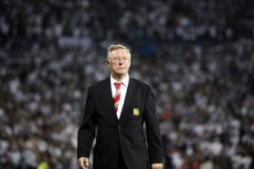 Manchester United's manager Alex Ferguson walks before their Champions League soccer match aganist Besiktas at the Inonu Stadium in Istanbul in this September 15, 2009 file photograph. Alex Ferguson, Britain's longest-serving and most decorated soccer manager, will retire at the end of the season after more than 26 years and nearly 1,500 matches at the helm of Manchester United, he announced on May 8, 2013.  REUTERS/Osman Orsal/Files    (TURKEY - Tags: SPORT SOCCER)