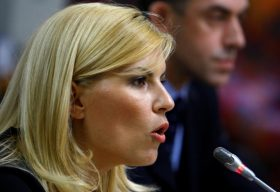 FILE PHOTO: Romania's Tourism Minister Elena Udrea speaks in front of a parliamentary commission at Romania's Parliament palace in Bucharest, Romania, August 20, 2009.  REUTERS/Bogdan Cristel/File Photo
