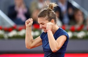 MADRID, SPAIN - MAY 13: Simona Halep of Romania celebrates defeating Kristina Mladenovic of France in the final during day eight of the Mutua Madrid Open tennis at La Caja Magica on May 13, 2017 in Madrid, Spain. (Photo by Julian Finney/Getty Images)