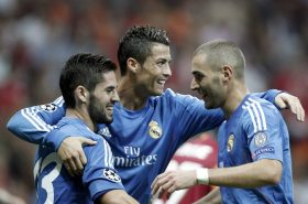 Real Madrid's Cristiano Ronaldo (C) celebrates a goal with team mates Isco (L) and Karim Benzema against Galatasaray during their Champions League Group B soccer match at Turk Telekom Arena in Istanbul September 17, 2013.     REUTERS/Osman Orsal (TURKEY  - Tags: SPORT SOCCER)