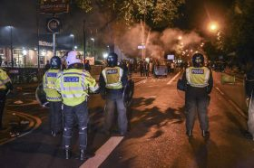 """LONDON, UNITED KINGDOM - JUNE 26: Police intervene in as demonstrators erect barricades and set fires to roads near the Forest Gate police station in London, England, United Kingdom on June 26, 2017 during a demonstration protesting the death of a 25-year-old black male Edir Frederico Da Costa (Edson). The disturbance followed a Black Lives Matter protest after the death of Edir Frederico Da Costa (Edson) six days after he was arrested by police. Protesters demanded answers to questions surrounding Da Costa's death and threw bricks at police while chanting """"Justice for Edson!"""" Da Costa was in a car with two other people when it was stopped by police in the Newham area in East London. Behlul Cetinkaya / Anadolu Agency"""