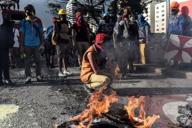 CARACAS, VENEZUELA - JUNE 26: Protesters set up fire during a protest demanding Venezulan President Nicolas Maduro's resignation and new elections in Caracas on June 26, 2017 A political and economic crisis in the oil-producing country has spawned often violent demonstrations by protesters demanding Maduro's resignation and new elections. The unrest has left 75 people dead since April 1. Carlos Becerra / Anadolu Agency