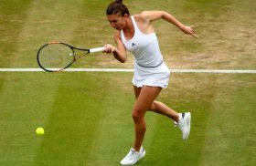 LONDON, ENGLAND - JULY 04:  Simona Halep of Romania plays a forehand during the Ladies Singles fourth round match against Madison Keys of the UNited States on day seven of the Wimbledon Lawn Tennis Championships at the All England Lawn Tennis and Croquet Club on July 4, 2016 in London, England.  (Photo by Clive Brunskill/Getty Images)