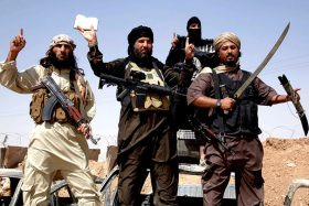 Islamic state fighters removing the border between Syria and Iraq (Newscom TagID: zumaglobal333109.jpg) [Photo via Newscom]