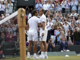 Luxembourg's Gilles Muller, right, greets Spain's Rafael Nadal after winning their Men's Singles Match on day seven at the Wimbledon Tennis Championships in London Monday, July 10, 2017. (AP Photo/Tim Ireland)