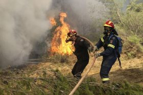 ATHENS, GREECE - AUGUST 15 : Firefighters battle with a wildfire which has been continuing for three days, in Kalamos region of Athens, Greece on August 15, 2017. High winds are driving wildfires near the Greek capital Athens, forcing residents and holidaymakers to flee. More than 20 houses have already been damaged as the blazes, which began on Sunday, burned through pine forests north of the city. Around 150 firefighters, with the help of helicopters and planes, are still battling to contain fires in the coastal areas of Kalamos and Varnava. Ayhan Mehmet / Anadolu Agency
