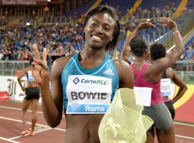 US athlete Tori Bowie celebrates after winning the women's 100m event during the IAAF Diamond League Golden Gala at Rome's Olympic Stadium on June 5, 2014.   AFP PHOTO / TIZIANA FABI        (Photo credit should read TIZIANA FABI/AFP/Getty Images)
