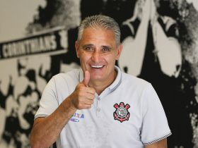FILE - Corinthians soccer coach Adenor Leonardo Bacchi, known as Tite, flashes a thumbs up as he poses after a team training session at the Itaquerao stadium, in Sao Paulo, Brazil, on December 5, 2015. Photo: AP